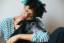 Young Woman Hugging Greyhound