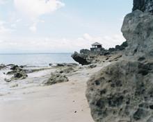 Cute Little House On The Rocks, Beautiful Cliffs Seaside Scene. Shot By 120 Films