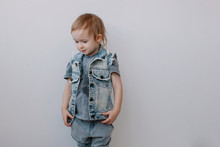 Stylish Boy Wearing Denim Posing In White Studio And Looking Away