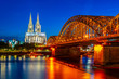 Night view of the cathedral in Cologne and Hohenzollern bridge over Rhein, Germany