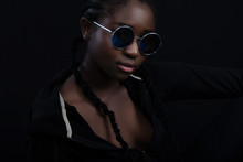 Confident And Cool Woman With Dark Skin Wearing Round Sunglasses