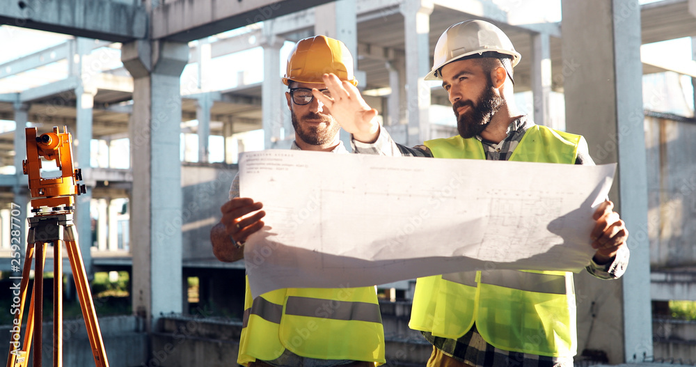 Fototapeta Portrait of construction engineers working on building site