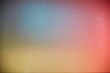 Pink gray and yellow colors in a blur on a textural background