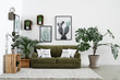Leinwanddruck Bild - Interior of modern room with comfortable sofa and houseplants