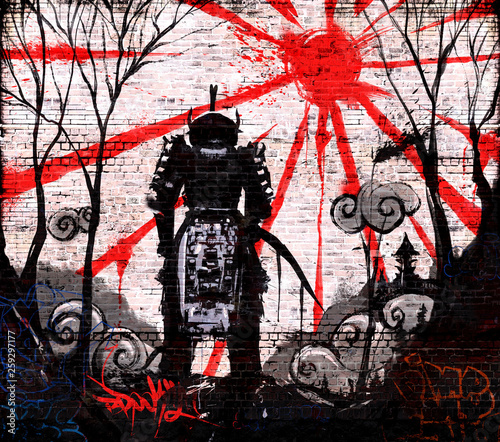 Graffiti on a brick wall of ronin lowered his head and stands against the sunset