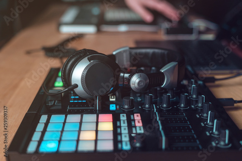 DJ Adult man creates electronic music in the studio - 259309337