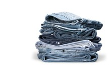Pile Of Blue Jeans Over White ...