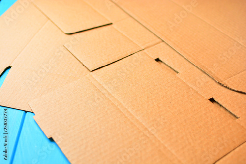 Valokuva  Unwrapping cardboard package box background