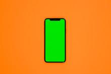 IPhone XS, Smartphone, Green Screen On Orange Background Top View
