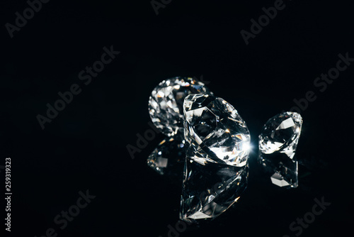 Fototapeta transparent pure diamonds isolated on black with reflection