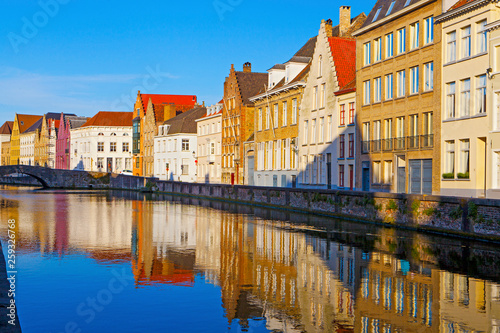 Wall Murals Bridges Streets of Brugge with colourful houses , reflecting in the river, Belgium
