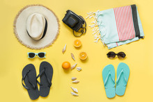 Beach Accessories For Two, Straw Beach Sunhat,towel, Sun Glasses On Yellow. Summer Concept And Tropical Vacations.