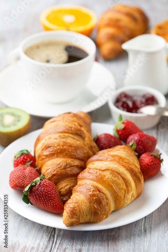 Continental breakfast table with coffee, orange juice, croissants Wallpaper Mural