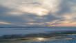 Frozen sea. Snow landscape. Sunset