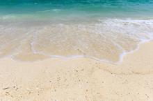 Waves Splashing On White Beach