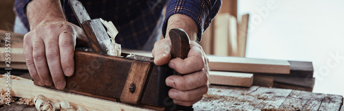 Fotografering Panorama banner of a carpenter planing wood
