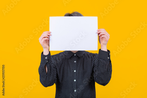 woman cover face with paper Wallpaper Mural