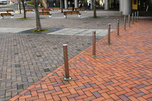 Safety Bollards On Walkway, Barrier For Road, Sidewalk And Different Pavement, Concept Image For Urban And Landscape Design.