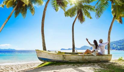 Fototapeta na wymiar Happy Couple Relaxing on the Ocean. Seychelles island