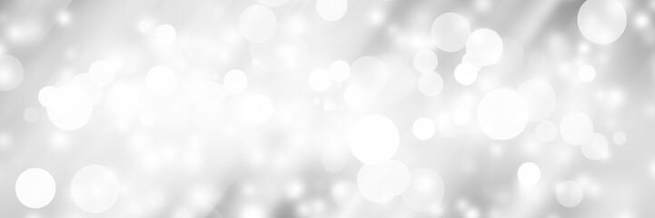 Fototapeta na wymiar white blur abstract background. bokeh christmas blurred beautiful shiny Christmas lights