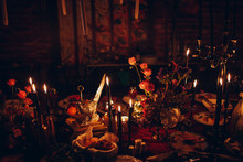 Table Wedding Decor. Pink, Blue And Red Flowers Bouquet And Candles In Bottles.