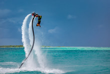 Professional Pro Fly Board Rider In Tropical Sea, Water Sports Concept Background. Summer Vacation Fun Outdoor Sport