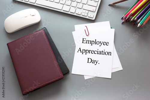 Text Employee appreciation day on white paper book and office supplies on wood d Canvas Print
