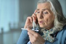 Upset Senior Woman Calling Doc...