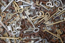 Many Different Old, Rusty Keys To Sell At The Flea Market. Close Up, Background And Texture