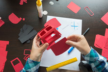 A Designer Working With Paper Modeling Template
