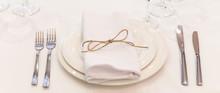 Plate, Forks, Napkin And Knife In Restaurant