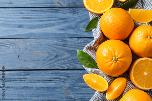 Fotografiet Flat lay composition with ripe oranges and space for text on wooden background