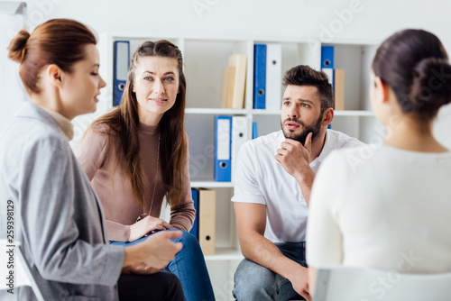 Fototapety, obrazy: group of people sitting and talking during therapy meeting