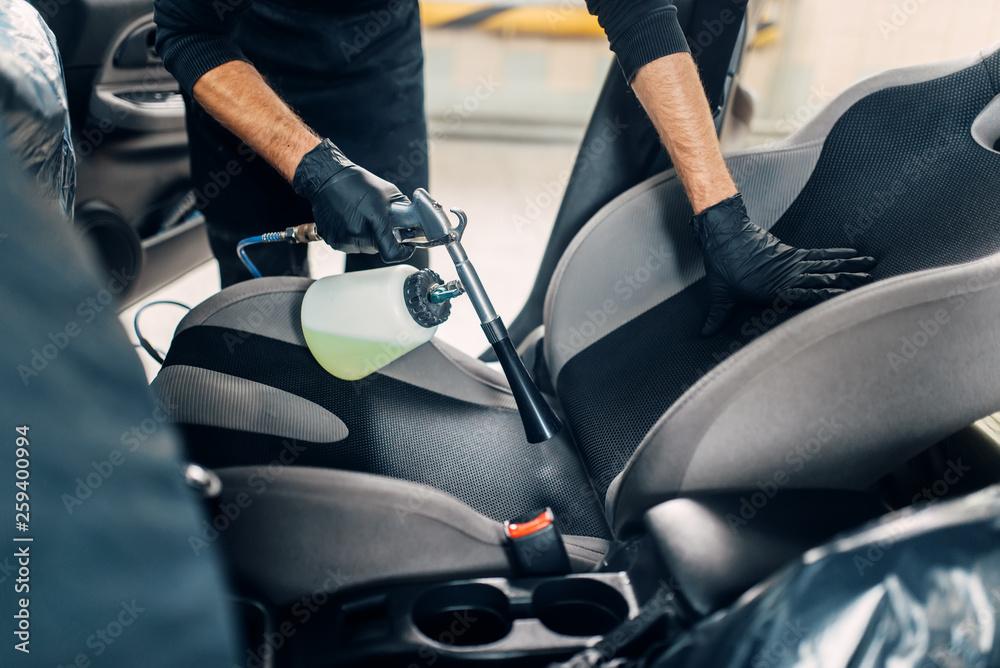 Fototapeta Professional dry cleaning of car interior