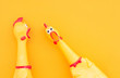 canvas print picture - Surprised chicken toys are isolated on a orange background, one looks at the camera and shouts, the other one to the side. Screaming chicken toys on a yellow background.