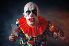 Mad Bloody Clown With Meat Cleaver And Human Hand