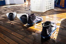 Flippers And Special Shoes For Diving And Snorkelling On A Boat