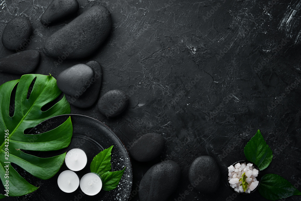 Fototapety, obrazy: Zen stones and leaves with water drops. Spa background with spa accessories on a dark background. Top view. Free space for your text.
