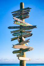 Rustic Wooden Sign Pointing Th...