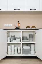 Dishware Storage Cabinet With Plates And Cups Inside