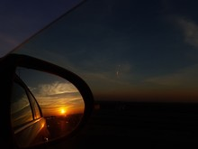 Sunset Reflection In The Car Mirror