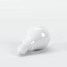 Outstanding White Light Bulb On White Background. All White Minimal Concept.