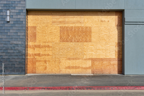 Preparation for hurricane - store, restaurant boarded up with plywood sheets Wallpaper Mural