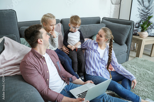 Happy family watching cartoons at home Canvas-taulu