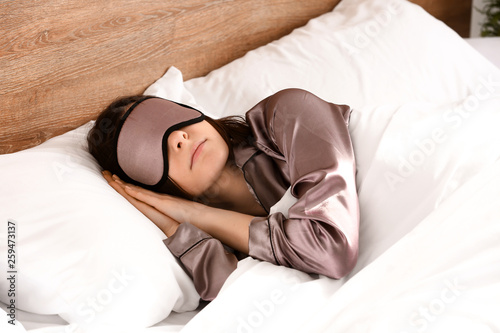 Fotografie, Obraz  Young woman with sleep mask in bed