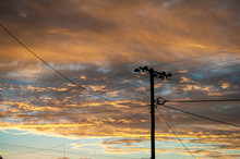 Silhouette Of A Power Lines In...