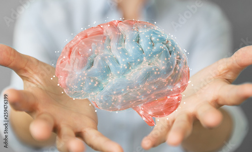 Obraz Businesswoman using digital 3D projection of a human brain 3D rendering - fototapety do salonu