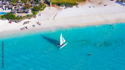 Foto auf AluDibond Sansibar White sailboat in a sea Zanzibar beach aerial view