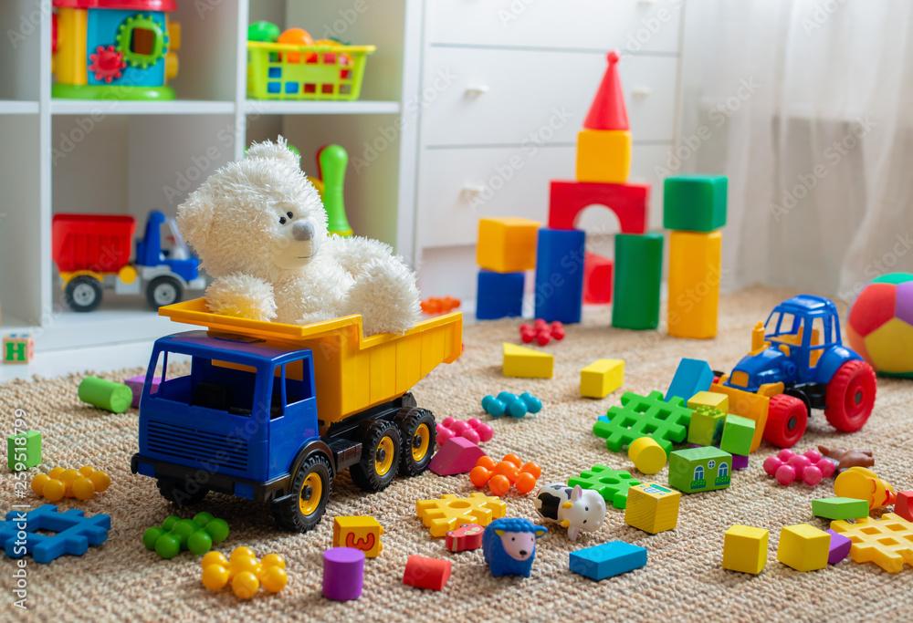 Fototapety, obrazy: Children's playroom with plastic colorful educational blocks toys. Games floor for preschoolers kindergarten. interior children's room.