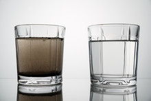 Close Up Glasses With Clean And Dirty Water
